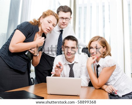 Manager with office workers on meeting in board room - in Hi Res - stock photo