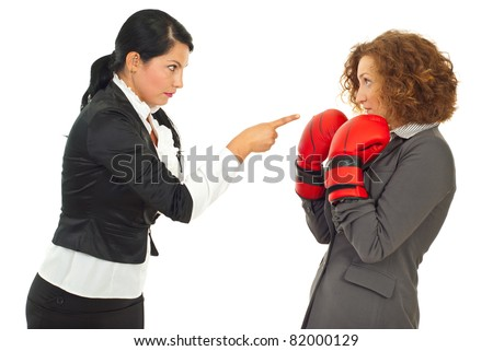 Manager woman pointing and accusing and employee woman who defending with boxing gloves isolated on white background