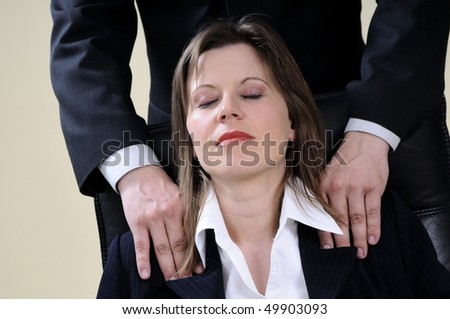 manager woman relaxing during massage - stock photo