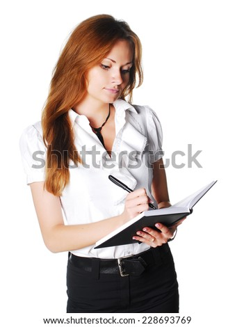 Manager writing something to the notepad - stock photo