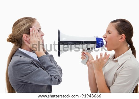 Manager yelling at her employee through a megaphone against a white background