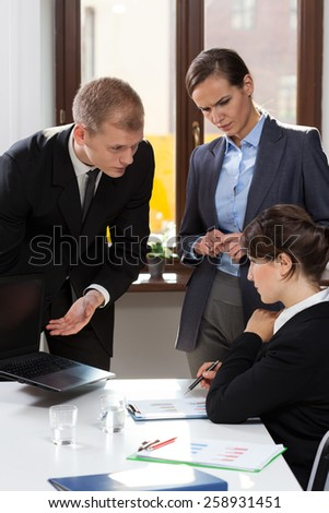 Managers being angry for employee who made mistake - stock photo