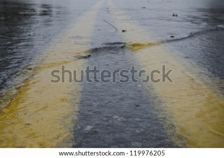 MANAHAWKIN,NJ-OCTOBER 30: Flood waters rise on the streets of Stafford Township as Hurricane Sandy makes landfall on October 30th, 2012. - stock photo
