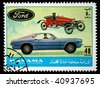 MANAMA (AJMAN) - CIRCA 1970s: A stamp printed in emirate Bahrain of the United Arab Emirates shows Ford cars, series, circa 1970s - stock photo