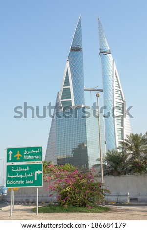 MANAMA, BAHRAIN - AUGUST 19, 2008: Bahrain World Trade Center - It is a 240-meter high and the first skyscraper in the world to integrate wind turbines into its design, on August 8, 2008 in Bahrain. - stock photo