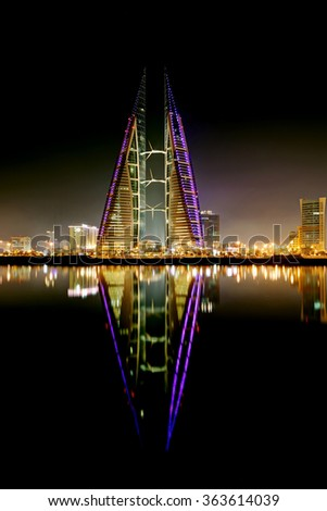 MANAMA, BAHRAIN - JANUARY 15: Bahrain World Trade Center at night, a twin tower complex is the first skyscraper in the world to have wind turbines, photographed on January 15, 2016, Manama, Bahrain - stock photo