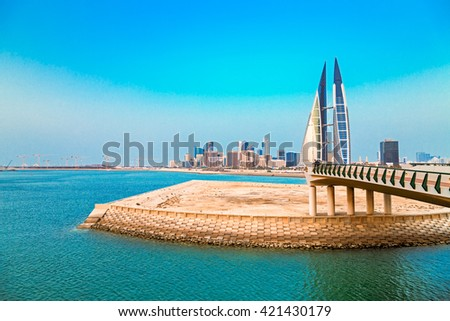 MANAMA, BAHRAIN- MAY 14: Manama Seafront with Bahrain World Trade Center and other high rise buildings in Manama City on a hazy evening on May 14, 2016, Manama, Bahrain - stock photo