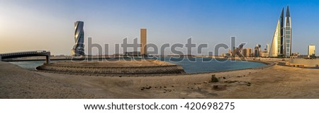 MANAMA, BAHRAIN- MAY 14: Panoramic image of Manama Seafront with Bahrain World Trade Center and other high rise buildings in Manama City on May 14, 2016, Manama, Bahrain - stock photo