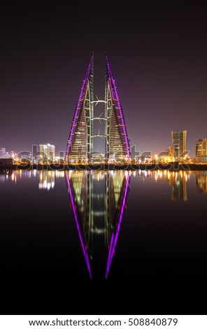 MANAMA, BAHRAIN - OCTOBER 15: Bahrain World Trade Center at night, a twin tower complex is the first skyscraper in the world to have wind turbines, photographed on October 30, 2016, Manama, Bahrain