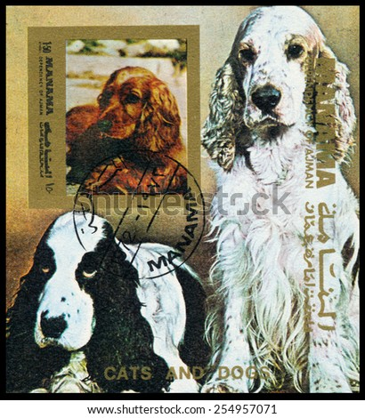 MANAMA - CIRCA 1972: Stamp printed in Manama shows dogs, circa 1972 - stock photo