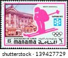 """MANAMA DEPENDENCY - CIRCA 1971: A stamp printed in United Arab Emirates from the """"1972 Winter Olympic Games - Sapporo, Japan"""" issue shows Men's downhill, circa 1971. - stock photo"""