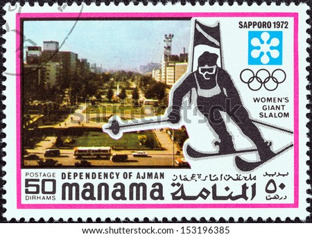 """MANAMA DEPENDENCY - CIRCA 1971: A stamp printed in United Arab Emirates from the """"1972 Winter Olympic Games - Sapporo, Japan"""" issue shows women's giant slalom, circa 1971.  - stock photo"""