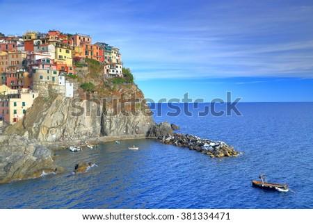 Manarola harbor and village near the Mediterranean sea at dusk, Cinque Terre, Italy - stock photo