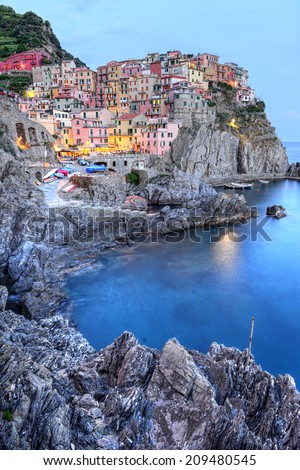 Manarola small town, from Cinque Terre, Italy, surprised at sunset. - stock photo
