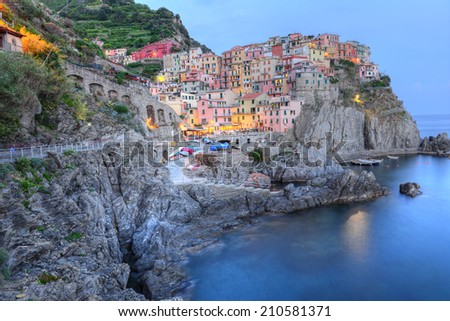 Manarola small town, from Cinque Terre, Italy, surprised at sunset, at blue hour. - stock photo
