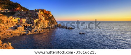 Manarola village on cliff rocks and sea at sunset., Seascape in Five lands, Cinque Terre National Park, Liguria Italy Europe. Panoramic view. - stock photo
