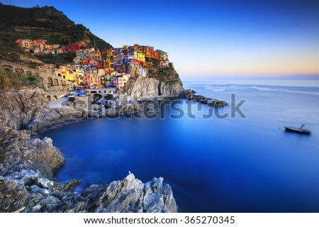 Manarola village on cliff rocks and sea at sunset., Seascape in Five lands, Cinque Terre National Park, Liguria Italy Europe. Long Exposure - stock photo