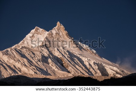 Manaslu mountain in its full glory at sunrise as taken from the small Tibetan village of Samagaon, located along the trail of the known Around Manaslu trek, Manaslu Himal, Nepalese Himalayas, Nepal