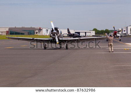MANASSAS, VA - MAY 6: AT-6 Texan, the Harvard training plane on runway at Manassas Air Show on May 6, 2011.This show brings military planes, helicopters and experimental aircraft to Manassas Airport.