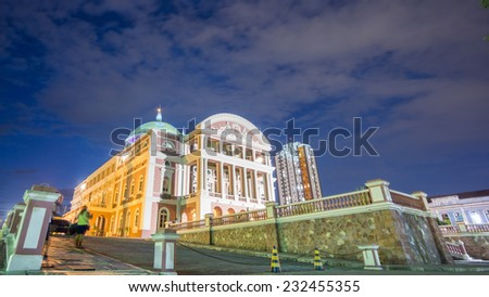 MANAUS - AUG 9: Amazonas Theatre facade by night on August 9, 2014 in Manaus, Brazil. The opera house was built when fortunes were made in the rubber boom. - stock photo