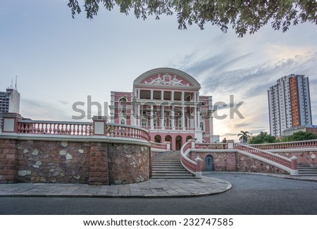 MANAUS - AUG 9: Amazonas Theatre facade on a cloudy day on August 9, 2014 in Manaus, Brazil. The opera house was built when fortunes were made in the rubber boom. - stock photo