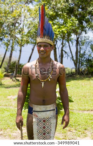 MANAUS, BRAZIL, MARCH 25: Brazilian Indian man wearing the feathers hat from tribe ritual in Amazon, Brazil 2015 - stock photo