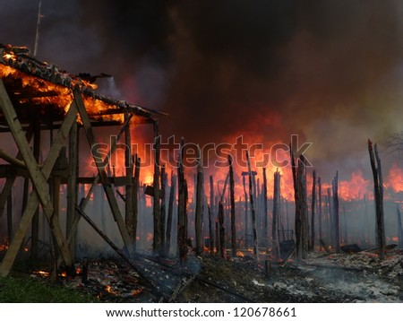 MANAUS, BRAZIL - NOV 27:  Large fire destroys countless stilt houses in the district of Sao Jorge in Manaus Amazonia, Brazil, Nov 27, 2012 - stock photo