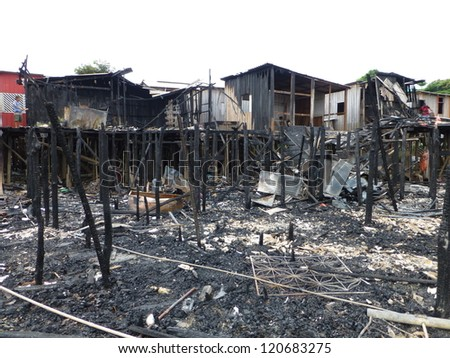 MANAUS, BRAZIL - NOV 27:  Large fire destroys countless stilt houses in the district of Sao Jorge in Manaus Amazonia. About 50 homes were destroyed by fire. Brazil, Nov 27, 2012