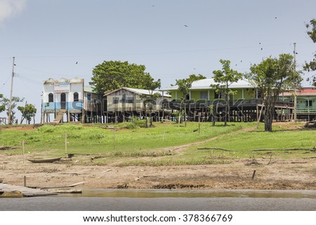MANAUS, BRAZIL, OCTOBER 17: Typical wooden wooden houses on Rio Negro near Manaus, Amazonas State. Brazil 2013