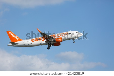 MANCHESTER AIRPORT - MAY 14th 2016: Easyjet Airbus A320 taking off from Manchester Airport, UK May 14, 2016 - stock photo