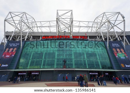 MANCHESTER, ENGLAND - APRIL 21: Old Trafford stadium is home to Manchester United one of the wealthiest and most widely supported football teams in the world.  Manchester April 21, 2013. - stock photo