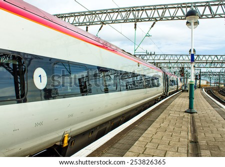 MANCHESTER, ENGLAND - DECEMBER 8, 2013. Train waiting on the platform in Piccadilly station in Manchester, England - stock photo