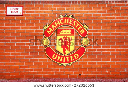 MANCHESTER, ENGLAND - FEBRUARY 17, 2014: Logo on the home team player zone in the Old Trafford stadium on February 17 ,2014 in Manchester, England. Old Trafford stadium is home to Manchester United. - stock photo