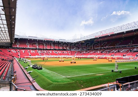 MANCHESTER, ENGLAND - FEBRUARY 17: Old Trafford stadium on February 17 ,2014 in Manchester, England. Old Trafford stadium is home to Manchester United. - stock photo