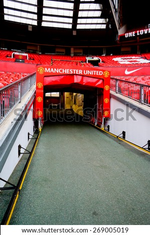 MANCHESTER, ENGLAND - FEBRUARY 17: Tunnel in Old Trafford stadium on February 17 ,2014 in Manchester, England. Old Trafford stadium is home to Manchester United. - stock photo
