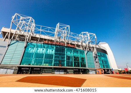 MANCHESTER, ENGLAND - MAY 29, 2016: Old Trafford stadium is home to Manchester United one of the wealthiest and most widely supported football teams in the world.