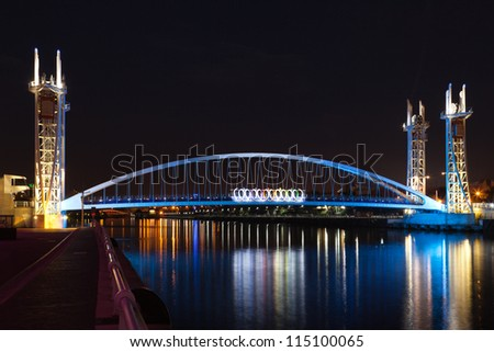 MANCHESTER, ENGLAND - OCT 2: Salford Quays Millennium Bridge on October 2nd, 2012 in Manchester, England.The counterbalancing system allows the bridge to raise or lower in less than three minutes - stock photo