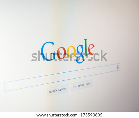 MANCHESTER - JAN 28: Google website home page on Jan. 28, 2014 in Manchester, UK. Google is an American multinational corporation specializing in Internet-related services and products. - stock photo