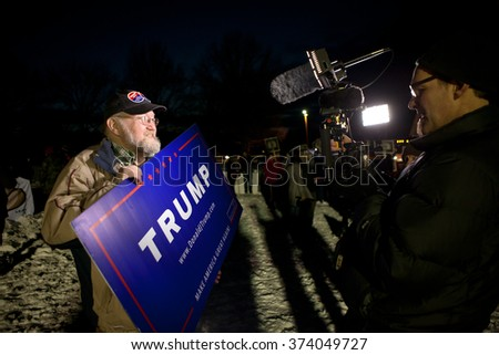 MANCHESTER, NH - FEBRUARY 6: Unidentified supporter of Presidential Candidate Donald Trump answers questions for the media prior to the Republican Primary Debate on February 6, 2016 in Manchester, NH.