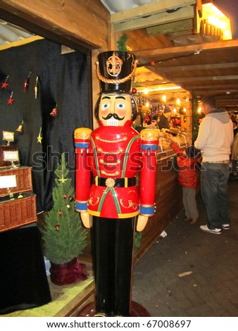MANCHESTER - NOVEMBER 27 : Large nutcracker at the Christmas Market on November 27, 2010 in Manchester, England. Manchester Xmas Market a yearly market, over 200 stalls and a major tourist attraction - stock photo