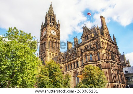 Manchester Town Hall, UK with cloudy sky - stock photo