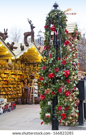 MANCHESTER,UK - DECEMBER 10: Wreathesfrom the Christmas market in front of the Manchester Town Hall, December 10, 2013. Manchester's award winning Christmas Markets returns to celebrate its 15th year - stock photo