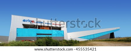 MANCHESTER, UK - JULY 19, 2016:The buildings are of an indoor skydiving tunnel company and behind the home to the UKs longest indoor skiing and indoor snowboarding slope - stock photo