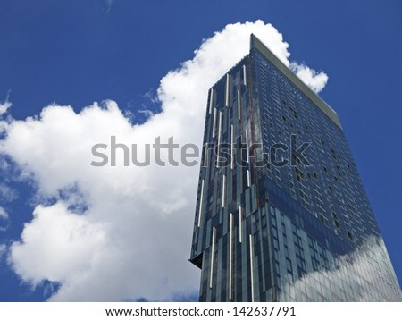 MANCHESTER,UK - JUNE 15: Beetham Tower is a 47-storey skyscraper designed by Ian Simpson. The tallest building in Manchester, was built in 2006, celebrates its seventh anniversary, 15 June 2013. - stock photo