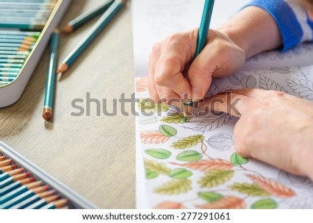 MANCHESTER, UK - May 2015: Colouring classes, England, UK, 10 May 2015. With the rise in popularity of adult colouring, clubs and courses have sprung up to share the hobby.