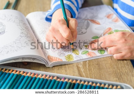 MANCHESTER, UK - May 2015: Colouring classes, England, UK, 10 May 2015. With the rise in popularity of adult colouring, clubs and courses have sprung up to share the hobby. - stock photo