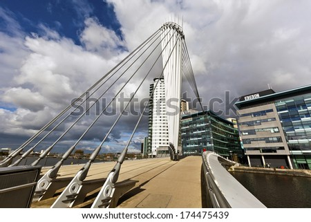 MANCHESTER, UK - OCTOBER 26 - The Media City Footbridge is a swing-mechanism  asymmetric cable-stayed bridge over the Manchester Ship Canal near MediaCityUK. Manchester October 26, 2012.  - stock photo