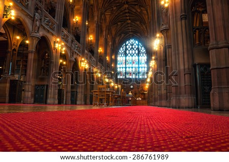 MANCHESTER, UK - SEPTEMBER 3, 2014: Inside a John Rylands Library - a late-Victorian neo-Gothic building and a famous landmark. Interior decoration of a main hall - stock photo