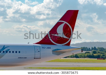 MANCHESTER, UNITED KINGDOM - AUG 07, 2015: Turkish Airlines Airbus A321 tail livery at Manchester Airport Aug 07 2015.