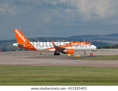 Manchester, United Kingdom - August 27, 2015: easyJet A319 narrow-body passenger plane  (G-EZON) taxiing on Manchester International Airport tarmac before departure. - stock photo